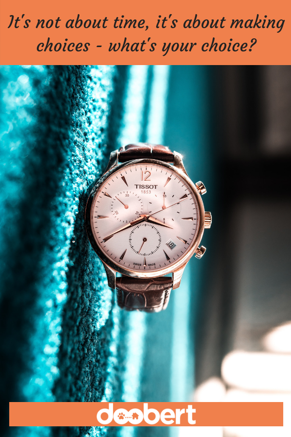 rose gold watch against teal background