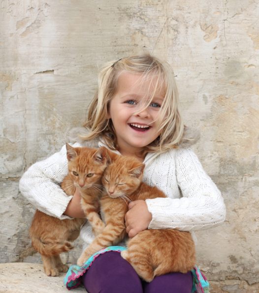 child with kittens